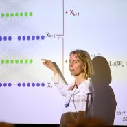 """MIT associate professor of electrical engineering and computer science Stefanie Jegelka, an IDSS affiliate, gives a talk at the 2019 Women in Data Science (WiDS) Cambridge conference entitled, """"What Can Neural Networks Represent?"""" Photo: Dana J. Quigley"""